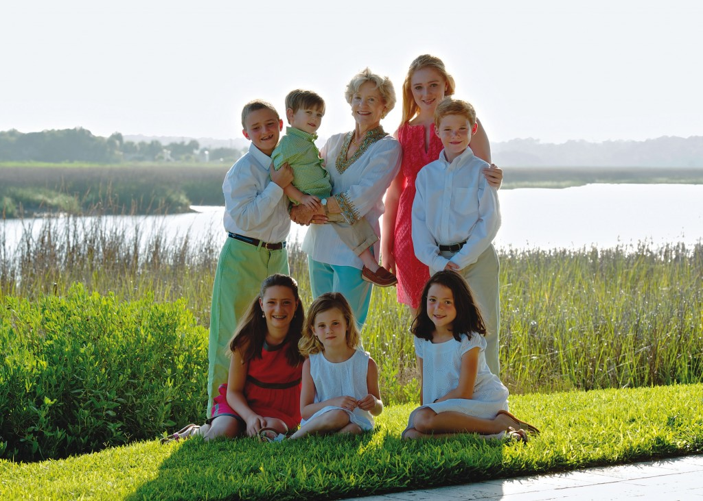 Gretchen Johnston Carpenter celebrated her 70th birthday with a family reunion at Sea Island. The festivities included Gretchen's daughters and their families. Here, Gretchen enjoys time with her seven grandchildren, ages 3 to 15, on The Cloister grounds overlooking Black Banks River. Scott Hopkins photography.