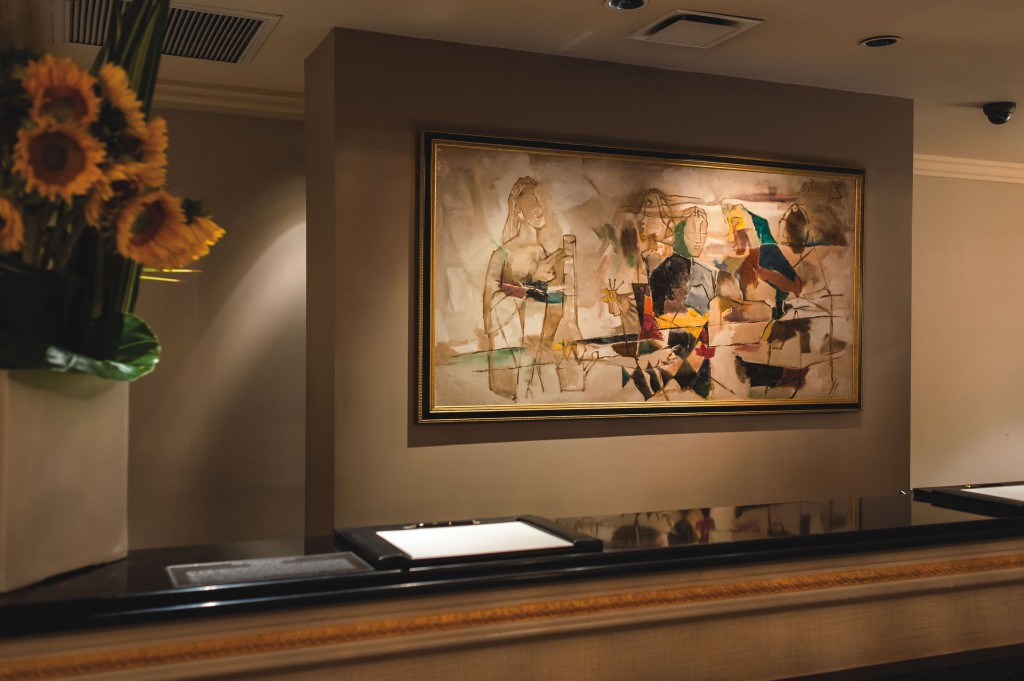 """""""Untold Story"""" by M.F. Husain hangs in the lobby at The Pierre. Adam lerner; artwork courtesy of TMP collection (Taj Mahal Palace, Mumbai)."""