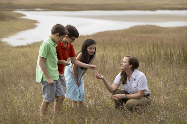 Raleigh Nyenhuis (right) works with the Sea Island Junior Naturalist Program.