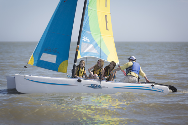 Sailing enthusiasts of all ages take to the water on Hobie catamarans at Sea Island.