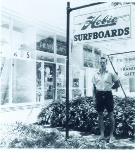 A young Alter in front of his surfboard shop | Courtesy of Hobie Designs