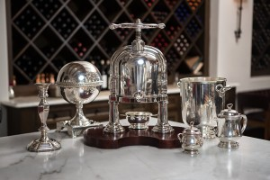 Sea Island's silver collection includes traditional pieces as well as rare ones, such as a duck press (center) and a caviar server (second from left).   Photo by Chris Moncus Photography