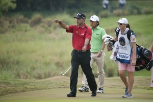 Jeev Singh (left) walks with his caddie during the Thailand Golf Championship in 2011.